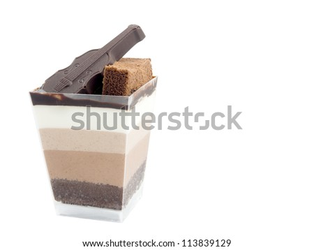 cup cake and dark chocolate in violin shape isolated on white - stock photo