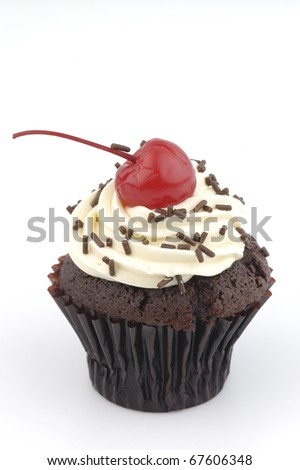 Cup cake and red cherry - stock photo