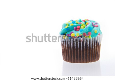 Cup cake isolated on a white background with reflection.