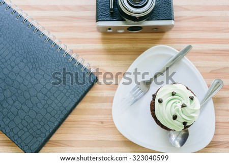 cup cake on wooden table in coffee shop.