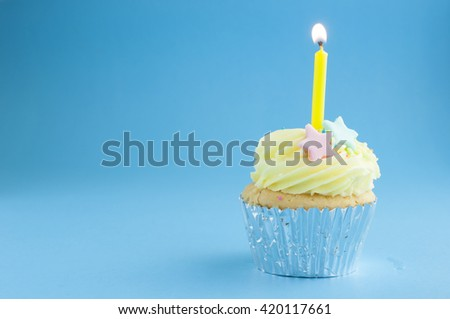 Cup cake with birthday candle light - stock photo