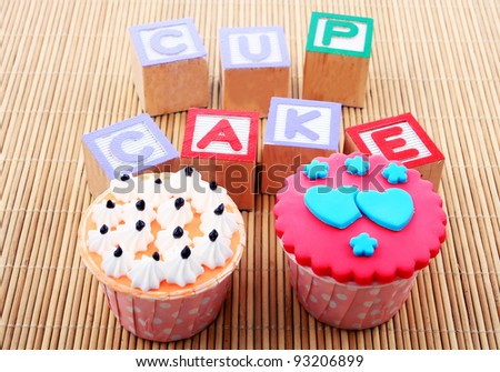 cup cake with word on bamboo mat