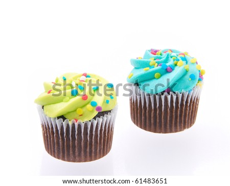 Cup cakes isolated on a white background with reflection.