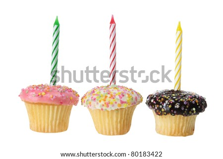 Cup Cakes with Birthday Candles on white Background - stock photo