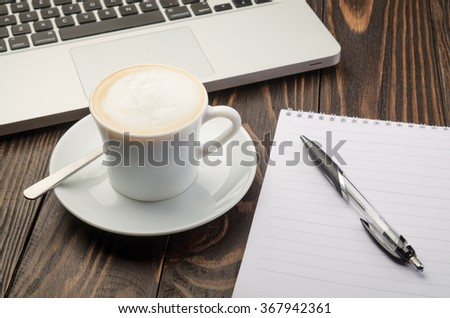 Cup Coffee, Computer and Note Pad on old wood background - stock photo