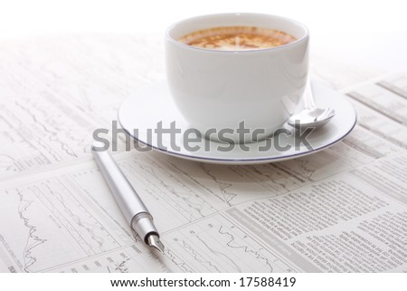 Cup coffee on a morning business newspaper - stock photo