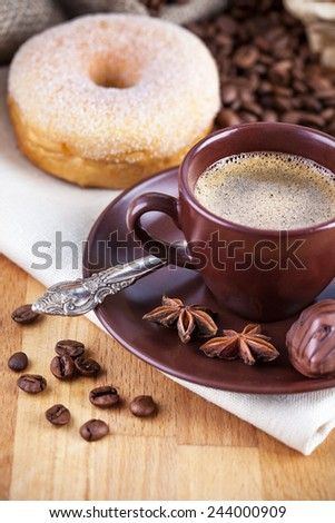 Cup coffee with beans and chocolate candies - stock photo