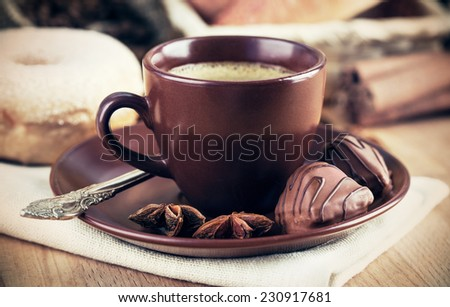 Cup coffee with chocolate pastries. - stock photo