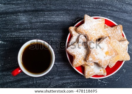 Cup espresso coffee and cookies on  a wooden background