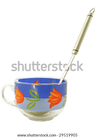 Cup for soup with a serving spoon