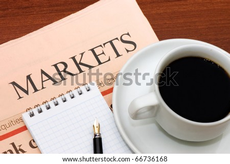 Cup from coffee and the newspaper - stock photo