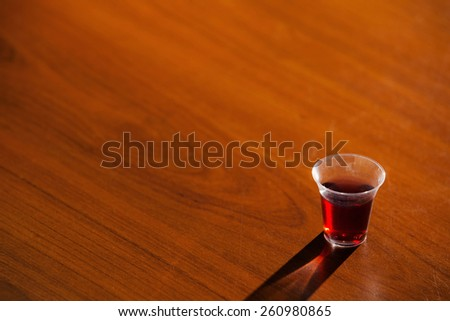 Cup From Holy Communion On Wood - stock photo