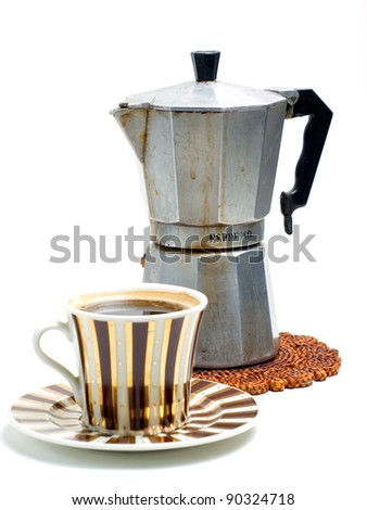 Cup full of black coffee and coffee cooker on a white background