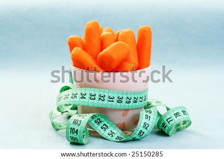 cup full of fresh carrots - on diet