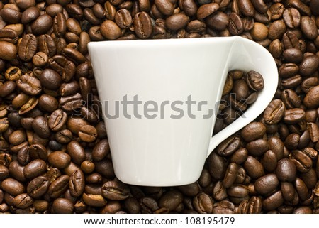 cup in coffee beans - stock photo