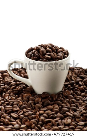 Cup in coffee beans. Isolated