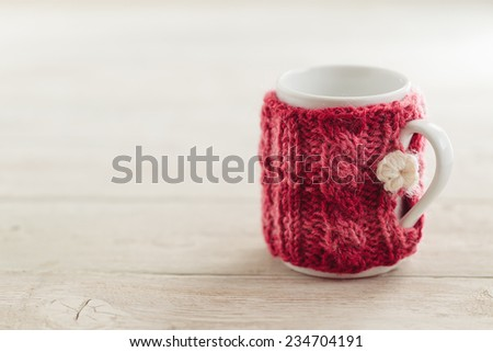Cup in sweater - stock photo