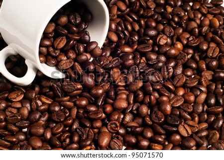 cup lies on the coffee beans
