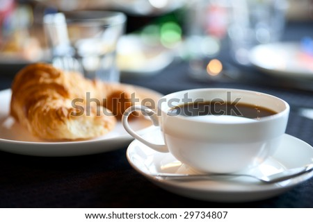 Cup of americano coffee, shallow focus - stock photo
