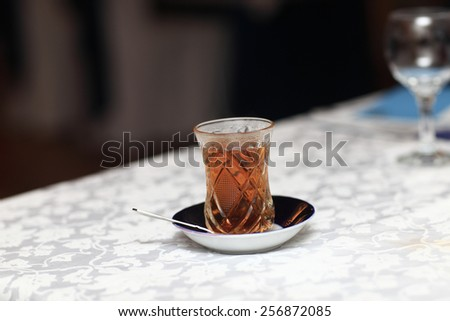 Cup of arabic tea on a table in the cafe - stock photo