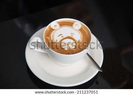 Cup of aromatic tasty cappuccino with the pattern of teddy bear - stock photo