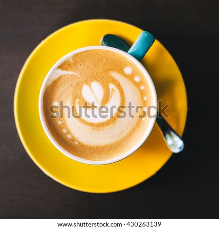 Cup of art latte or cappuccino coffee  - stock photo