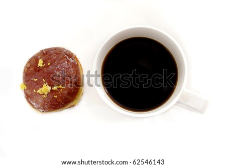 cup of black coffee and doughnut with icing topping. closeup white background