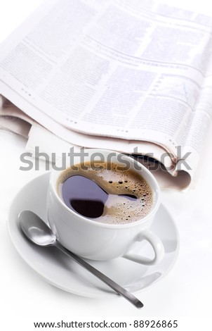cup of black coffee and newspaper
