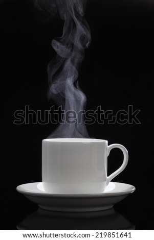 Cup of black coffee/Cup of black coffee with steam on the black background