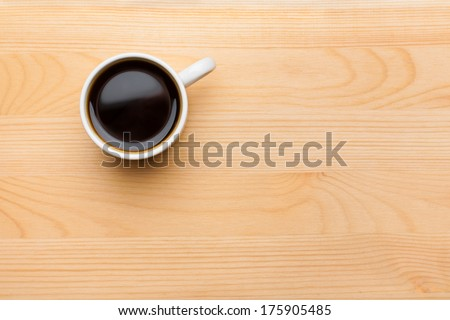 Cup of Black Coffee in White Ceramic Cup on Wooden Tabletop - stock photo