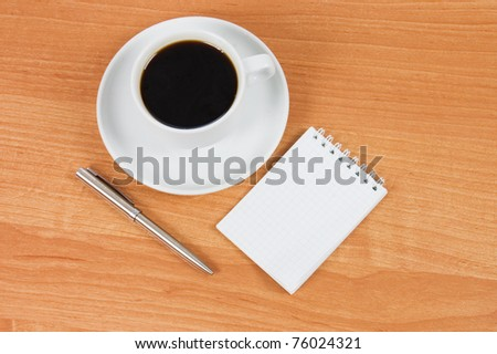 Cup of black coffee on wooden table - stock photo