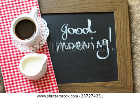 Cup of black coffee with milk and Good morning note - stock photo