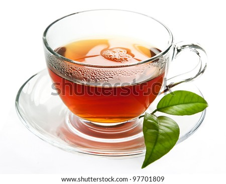 Cup of black, strong tea. - stock photo