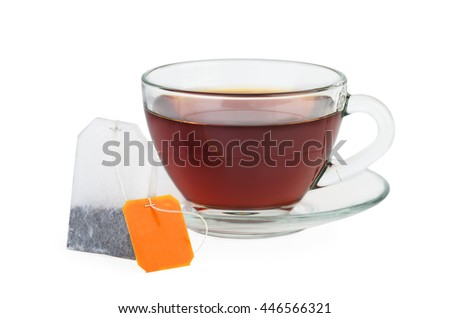 Cup of black tea and teabag isolated on white background - stock photo