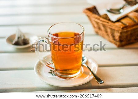 Cup of black tea in a glass
