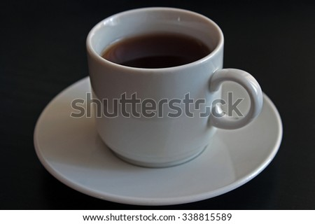 Cup of black tea on gray background - stock photo