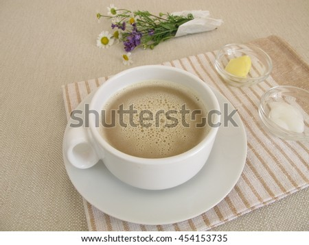 Cup of butter coffee - Black coffee with butter and coconut oil for breakfast