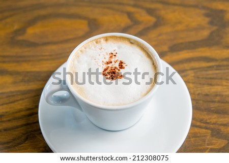 Cup of Cappuccino  and biscotti  - stock photo