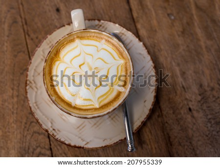 Cup of cappuccino coffee on a wooden background, Coffee shop - stock photo