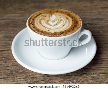 Cup of Cappuccino Coffee with Latte Art. - stock photo