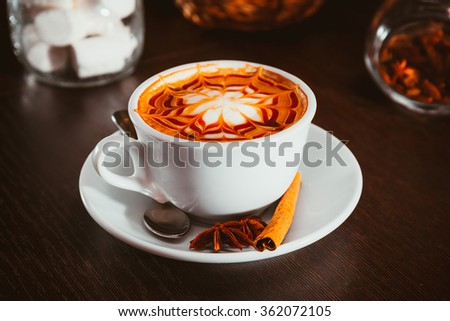 Cup of cappuccino in a coffee shop - stock photo