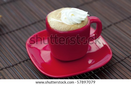 cup of cappuccino on a bamboo mat