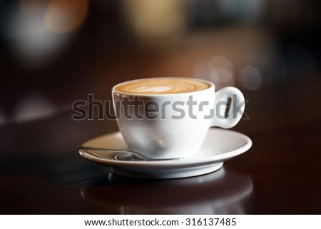 Cup of cappuccino on bar counter