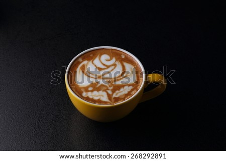 Cup of cappuccino on dark background - stock photo