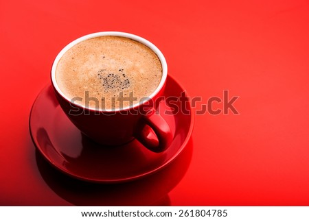 Cup of cappuccino on red background - stock photo