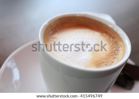 Cup of cappuccino on the table at cafe - stock photo