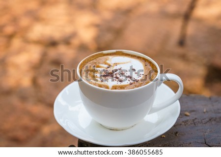 Cup of Cappuccino on wooden  table with chocolate. - stock photo