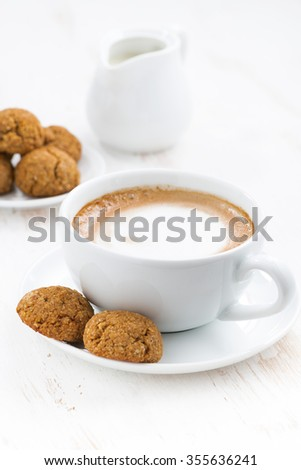 cup of cappuccino with almond biscuits, vertical