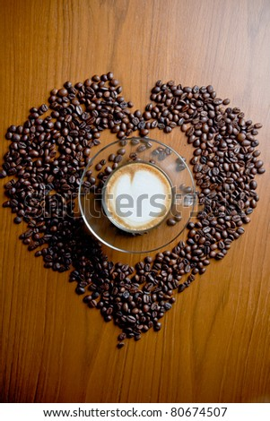 Cup of cappuccino with  coffee beans. - stock photo