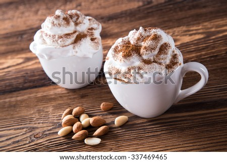 Cup Of Cappuccino With Whipeed Cream Over Wooden Table - stock photo